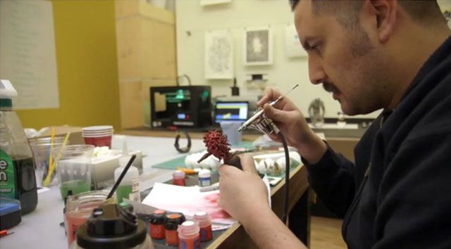 Juan Carlos Arenas working on one of the miniatures from the trailer