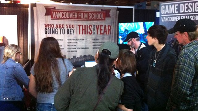 A crowd of interest in the Game Design Booth