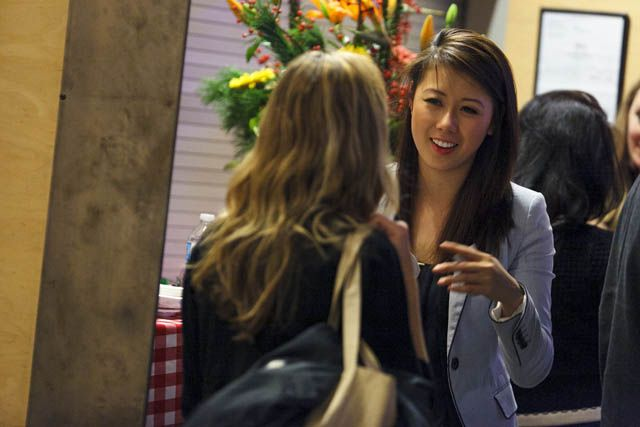 Student Samantha Chow discusses her project with Industry Representative