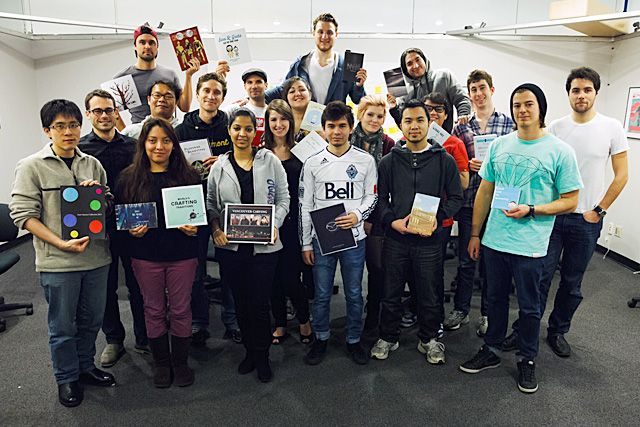 Digital Design's 25th class group shot with books