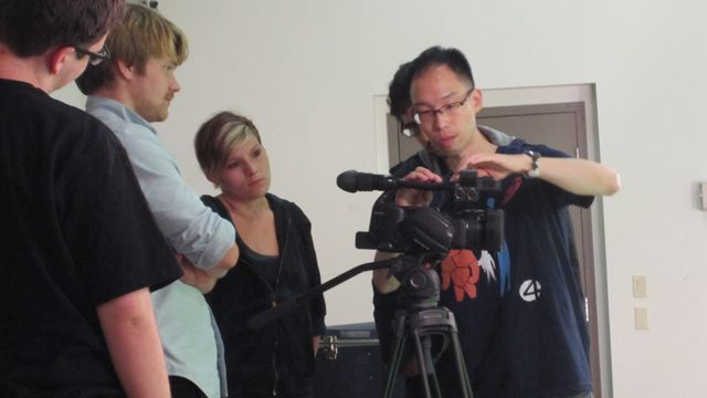 Danny Chan gives student's guidance and advice on shooting Green Screen